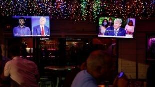 Donald Trump, Presidente cessante e candidato republicano, e Joe Biden, candidato democrata, debatem à distância.