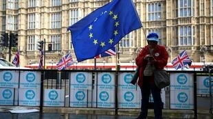 Anti-Brexit demonstrator in front of the British Parliament, 17 October 2019.