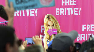 """A woman holds a """"Free Britney"""" sign during a rally in front of the Lincoln Memorial protesting the conservatorship of Britney Spears on July 14, 2021, in Washington, DC"""