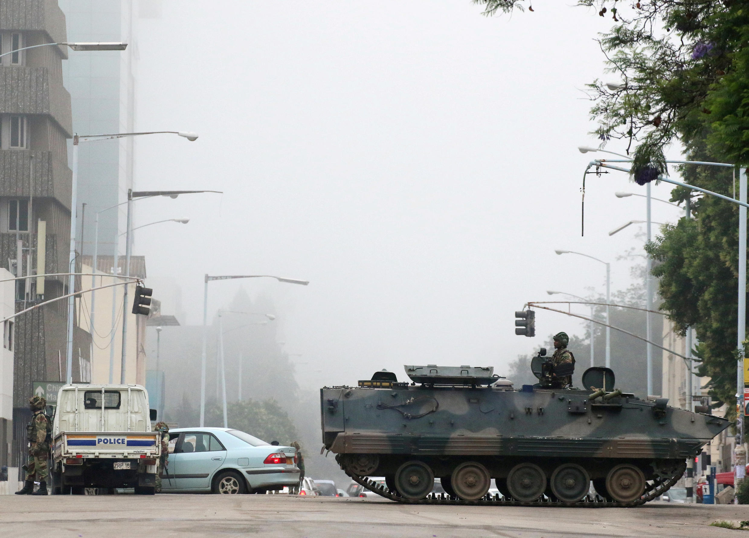 Military vehicles and soldiers patrol the streets in Harare, Zimbabwe, November 15,2017.