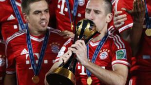 Với Bayern Munich, Frank Ribéry (phải) đã giànhh gần hết danh hiệu vô địch của mùa bóng 2013.