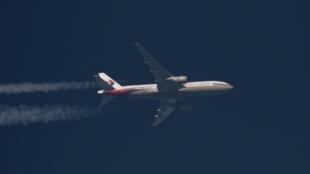 Một chiếc máy bay Boeing 777 của Malaysia Airlines trên bầu trời Ba Lan ngày 05/02/2014.