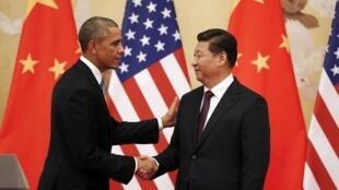 Les Etats-Unis et la Chine ont conclu un accord historique pour réduire les émissions de carbone. Ici, Barack Obama et Xi Jinping, le 12 novembre 2014.