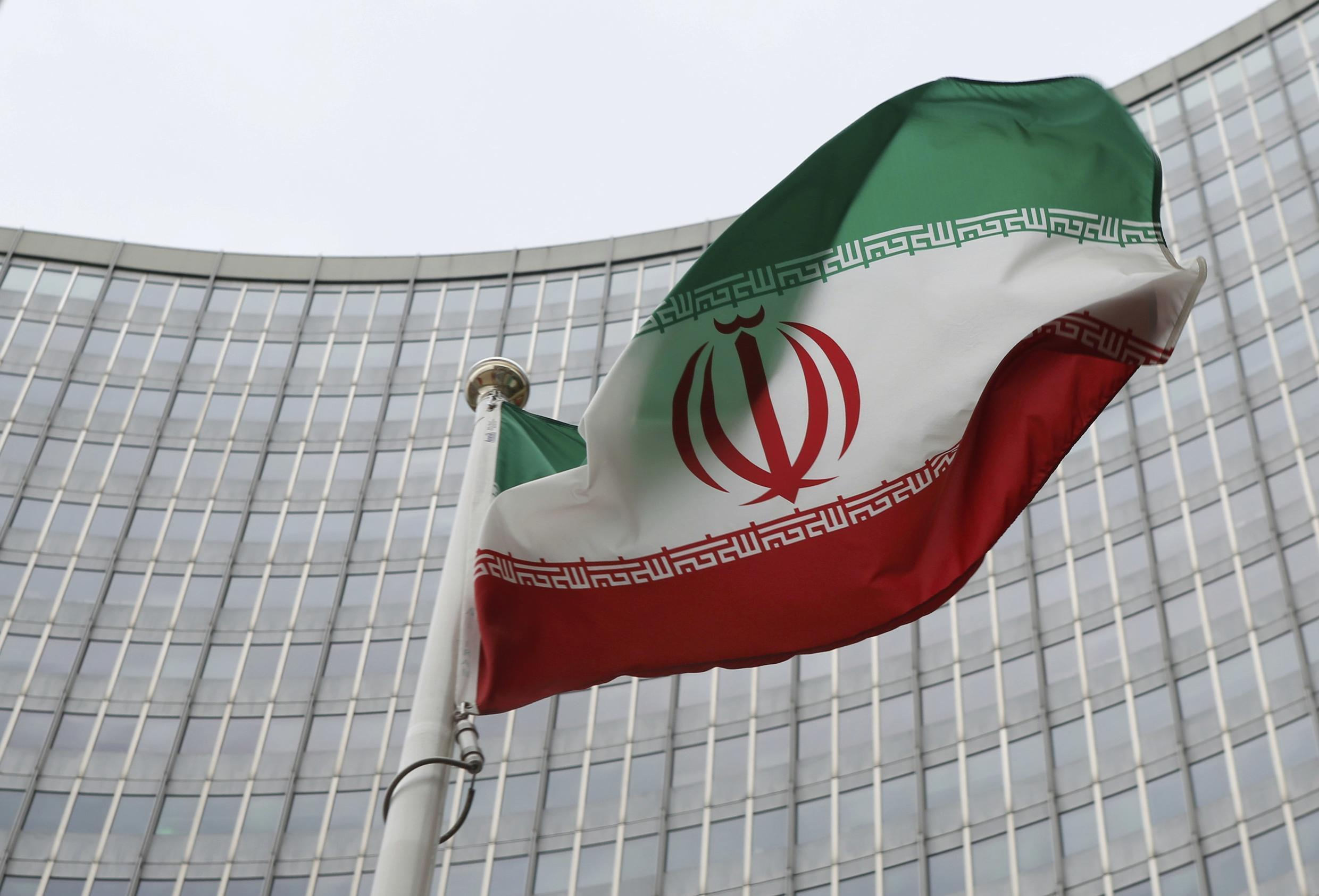 An Iranian flag flutters in front of the International Atomic Energy Agency (IAEA) headquarters in Vienna, Austria, January 15, 2016.