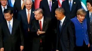 圖為習近平與奧巴馬共同參加參加G20土耳其峰會