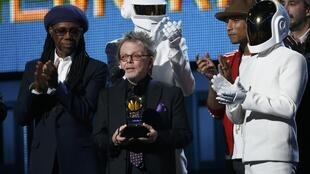 """Producer Paul Williams accepts the award for Album of the year for Daft Punk's """"Random Access Memories"""", at the 56th annual Grammy Awards in Los Angeles, 26 January 2014."""
