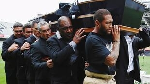 An official party carrries the casket of former All Black player Jonah Lomu during a memorial service at Eden Park in Auckland, New Zealand November 30, 2015.