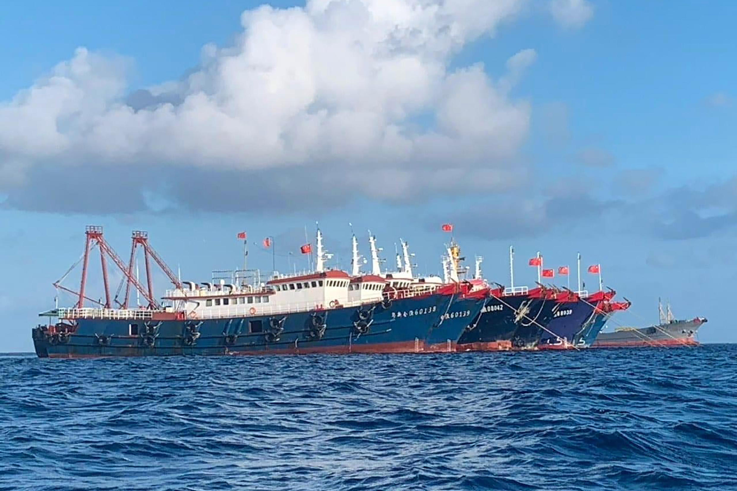 A fleet of Chinese vessels anchored at the Whitsun Reef has sparked a diplomatic row between Manila and Beijing