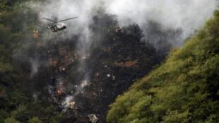 Imagem do local do acidente com o avião da Air Blue