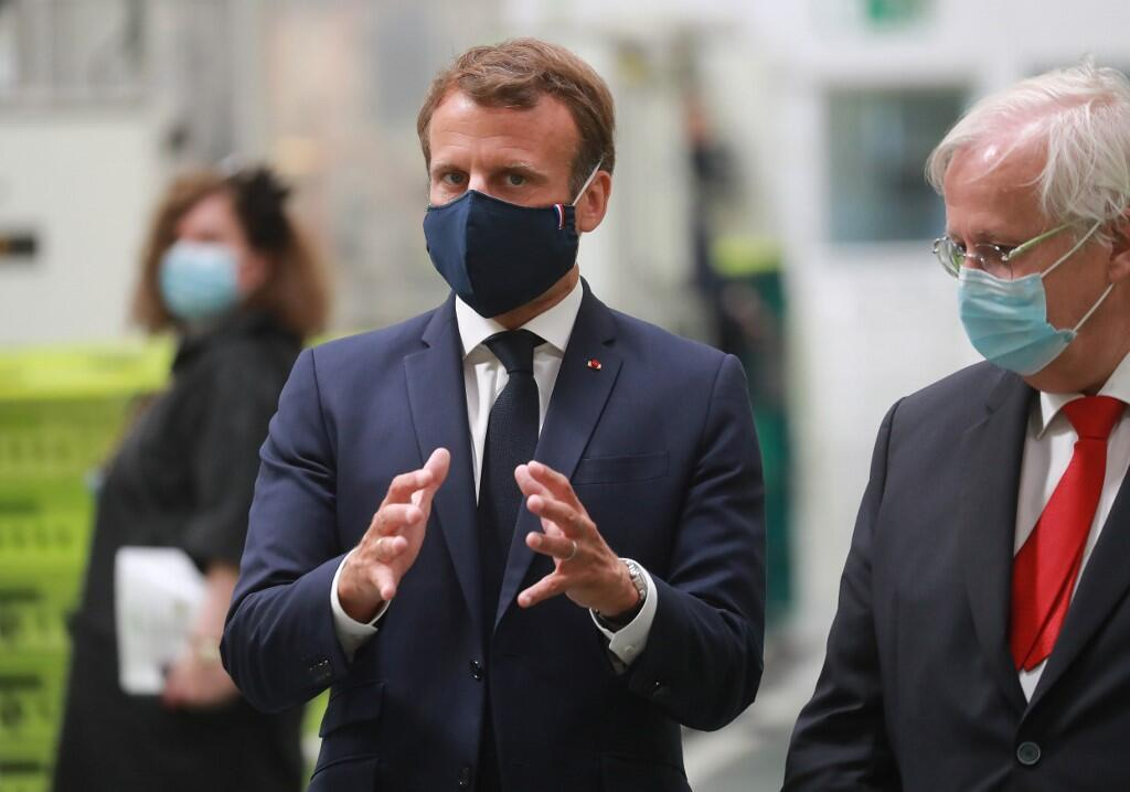 French President Emmanuel Macron wearing a protective facemask speaks as he visits a factory of manufacturer Valeo in Etaples, near Le Touquet, northern France, on May 26, 2020 as part of the launch of a plan to rescue the French car industry.