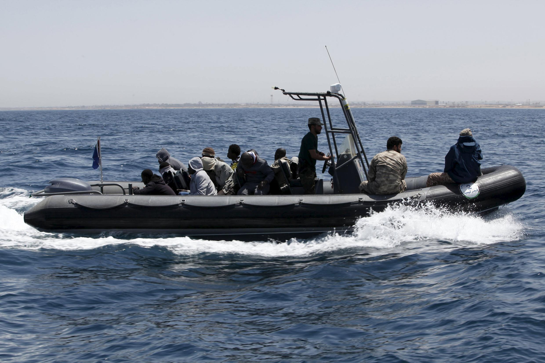 A boat carrying migrants leaves Libya