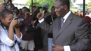 Presidential candidate Alassane Ouattara greets his supporters