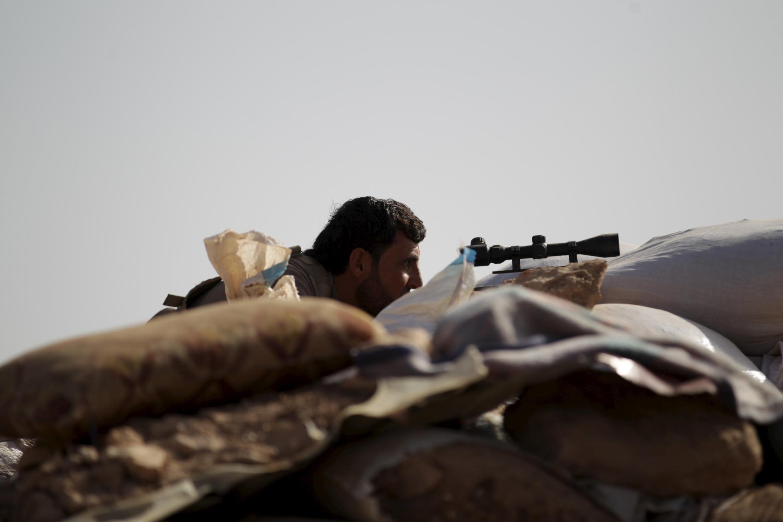 Un combattant de l'armée syrienne libre à Hama, le 14 octobre.