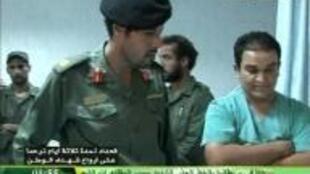 Hoton Bidiyon Khamis dan Muammar Gaddafi