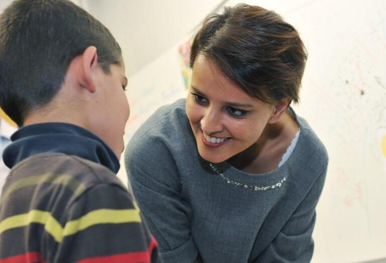 French Education Minister Najat Vallaud-Belkacem speaks with a schoolchild as she visits an elementary school in Blois.