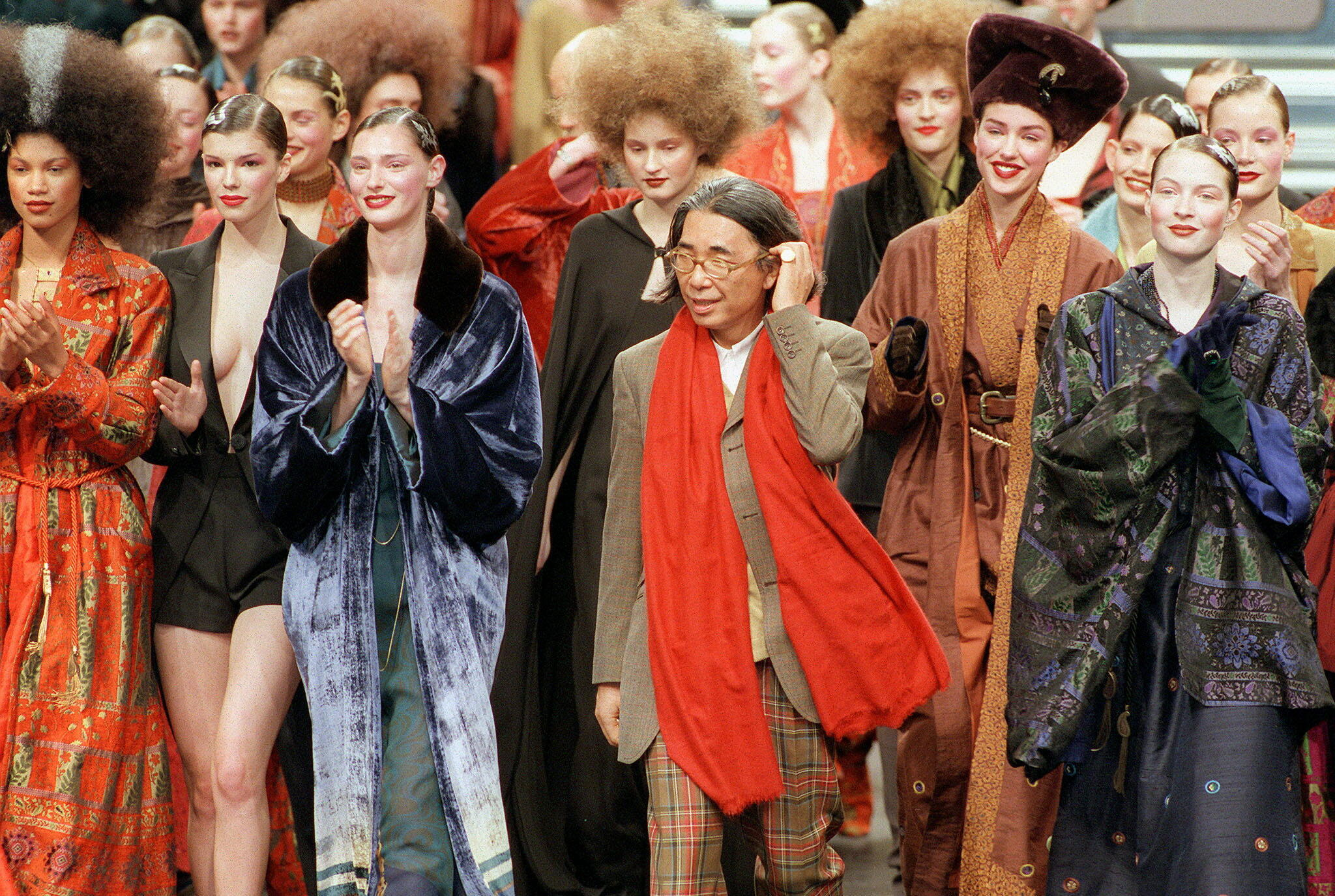 (FILES) In this file photo taken on March 13, 1998 Japanese fashion designer Kenzo (C) salutes the audience at the end of his's ready-to-wear Fall/Winter 1998/99 collection presentation in Paris. The founder of the Kenzo fashion house, Kenzo Takada, has died from from the novel coronavirus, Covid-19, his spokesperson announced in Paris on October 4, 2020.