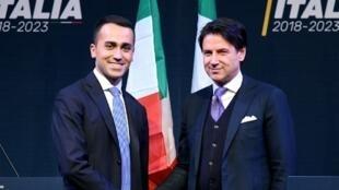 Giuseppe Conte (d) avec le chef de file du M5S Luigi Di Maio, le 1er mars 2018.
