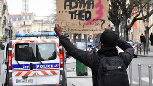 A demonstrator in Bordeaux asks who will be next after Adama Traoré, who died in police custody last year,  and alleged rape victim Théo