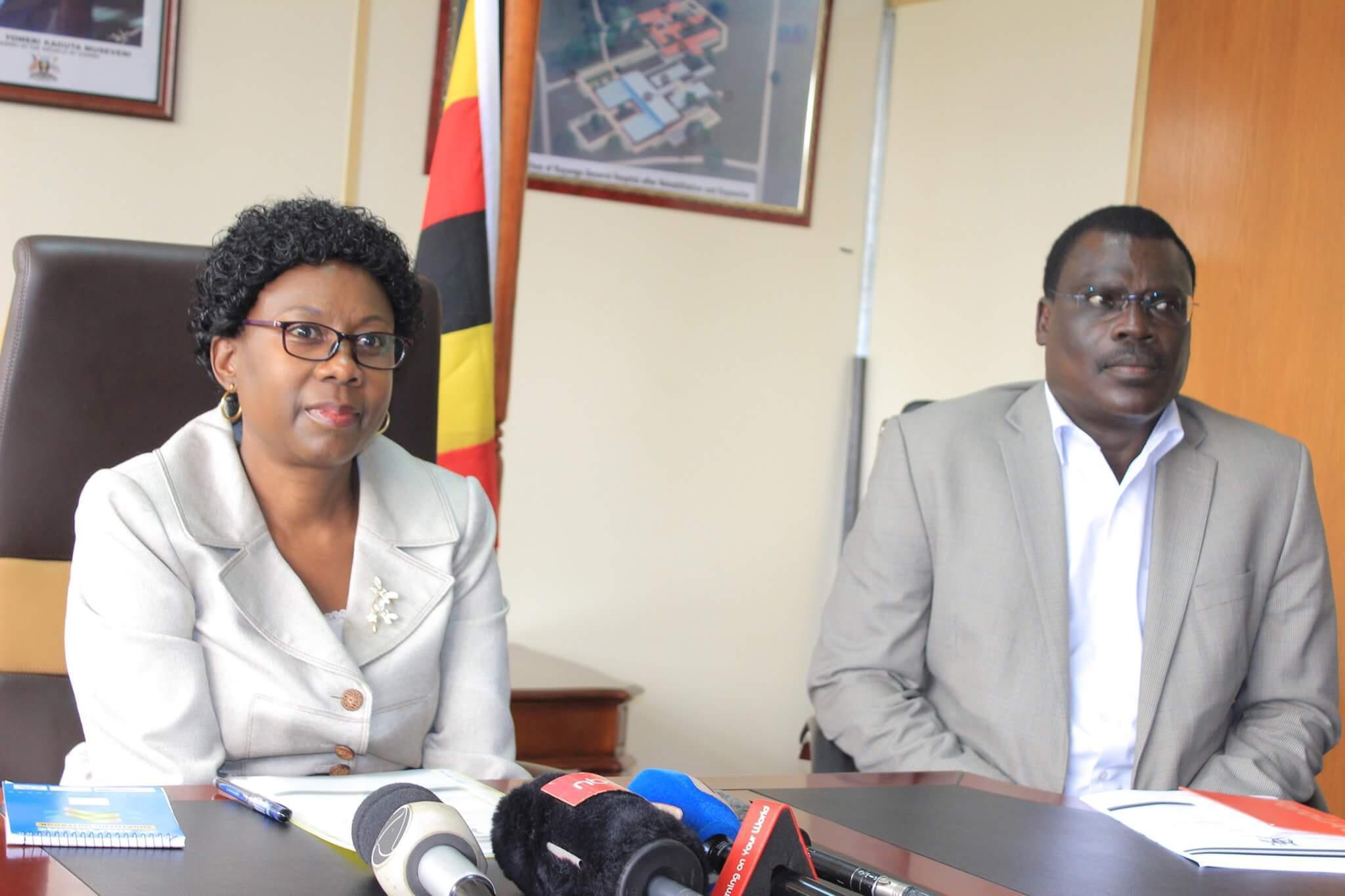 Ugandan Health Minister Dr. Jane Aceng addresses Kampala Press Conference with Dr Bernard Opar to her left