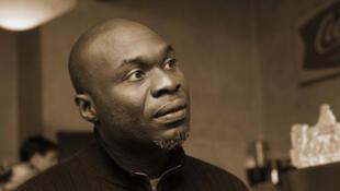 """Idrissou Mora-Kpai, réalisateur du film documentarie """"Indochine sur les traces de ma mère"""" présenté au Fespaco 2011."""