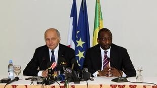French Foreign Minister Laurent Fabius with his Malian counterpart Tieman Hubert Coulibaly in Bamako on Friday