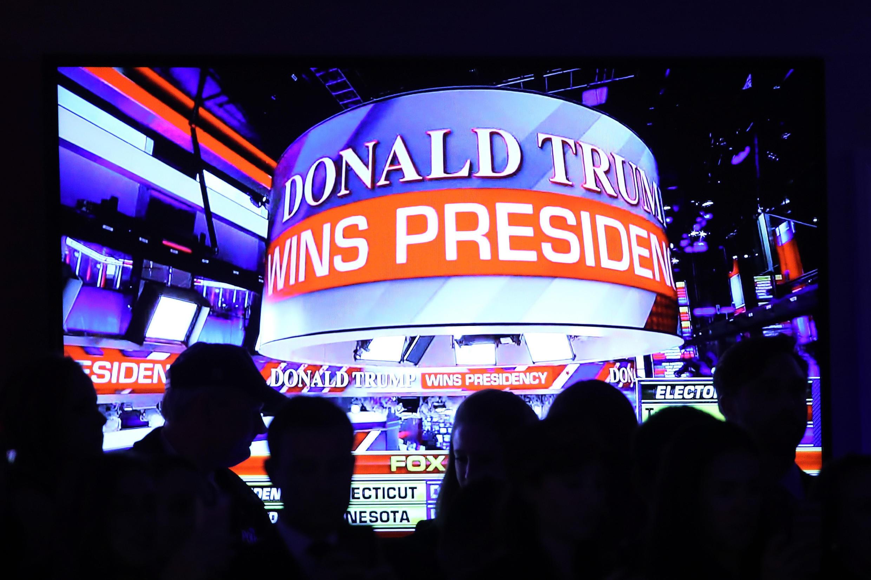 Les supporters célèbrent la victoire du républicain Donald Trump sur la candidate démocrate Hillary Clinton, à l'élection présidentielle. A New York, au le 9 novembre 2016.