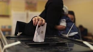 A woman votes in Egypt's election
