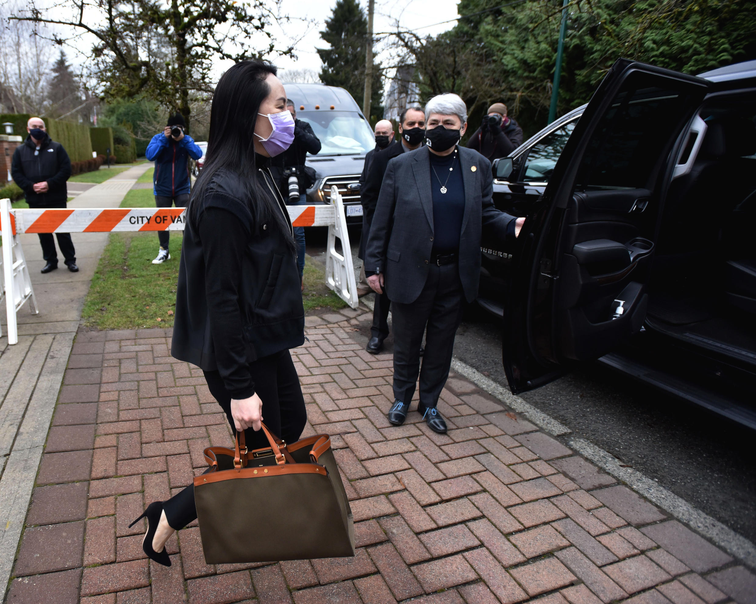 Huawei chief financial officer Meng Wanzhou leaves her Vancouver home for court. A Canadian judge rejected her request to relax her bail conditions