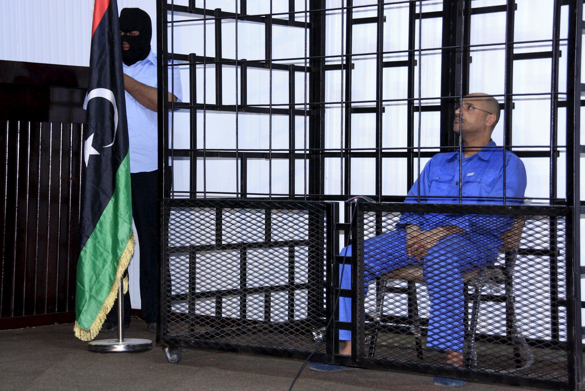 Сейф аль-Ислам Каддафи, сын бывшего ливийского лидера Муаммара Каддафи, удерживается повстанцами в городе Зентен, на юго-западе от Триполи, 25 мая 2014.