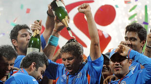 Indian cricketers celebrate after beating Sri Lanka in the 2011 ICC Cricket World Cup