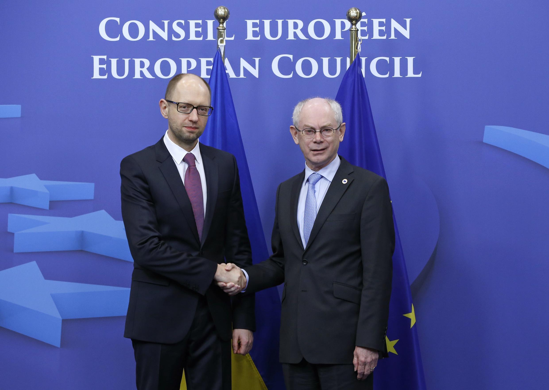 Ukraine's Prime Minister Arseniy Yatsenyuk (L) is welcomed by European Council President Herman Van Rompuy ahead of the Brussels emergency summit