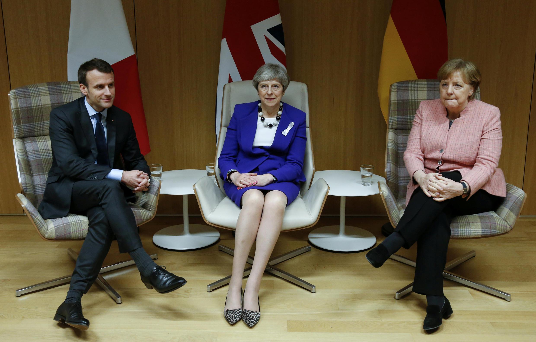 Mnamo Aprili 29, 2018, Emmanuel Macron, Theresa May na Angela Merkel walibanini kwamba  Umoja wa Ulaya (EU) hautokaa kimya kwa vikwazo vya kiuchumi vya Marekani kuhusu bidhaa za chuma na bati.