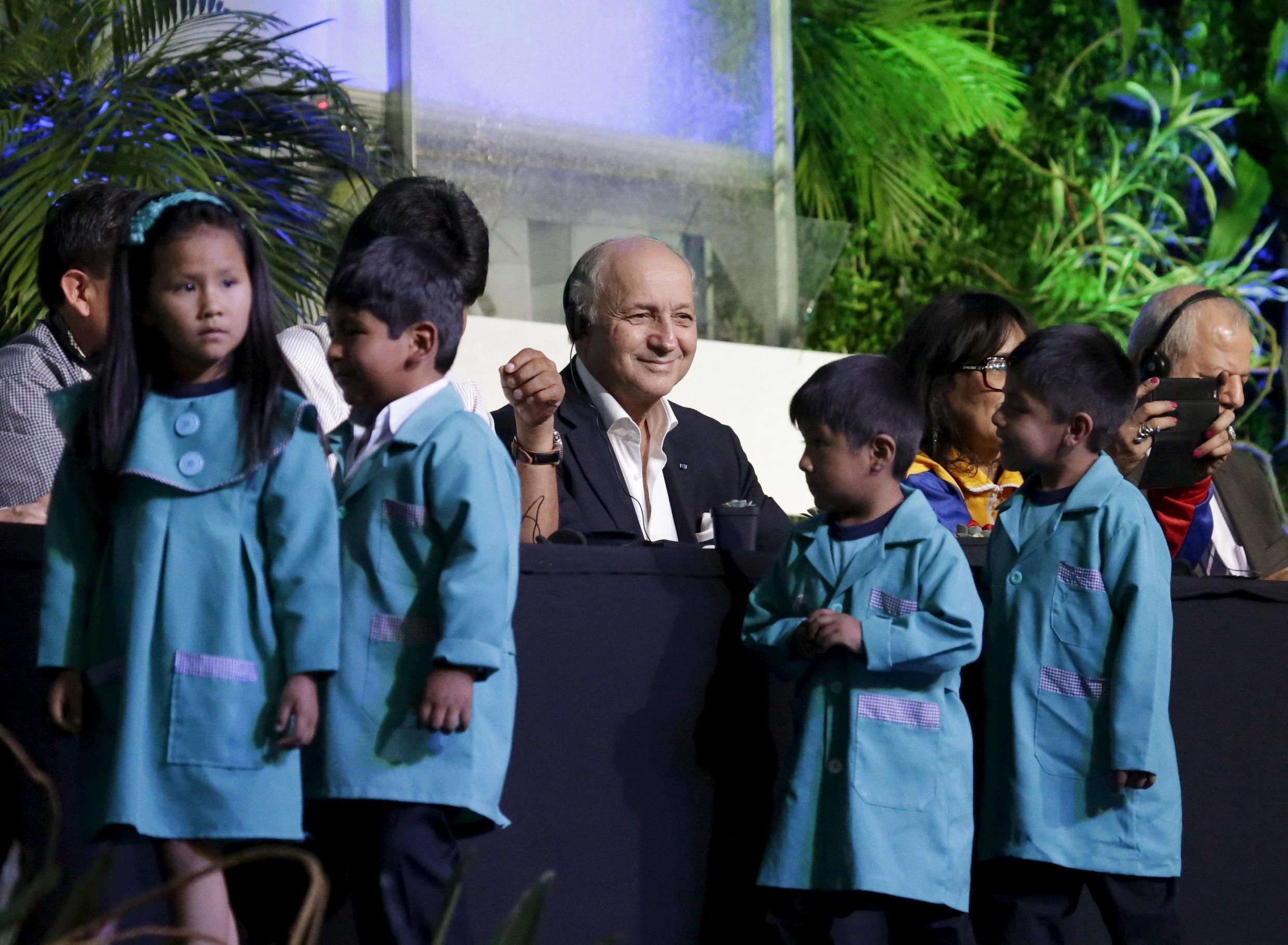 France's Foreign Minister Laurent Fabius is seen while school children participate at the inauguration of the World People's Conference on Climate Change, in Bolivia, October 10, 2015