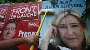 Posters for Jean-Luc Mélenchon and Marine Le Pen for the Legislative elections, in Hénin-Beaumont