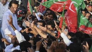 Imran Khan leads a PTI march against US drone attacks last October