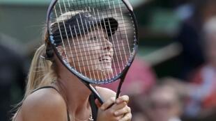 Maria Sharapova reacts after winning her women's semi-final match against Petra Kvitova