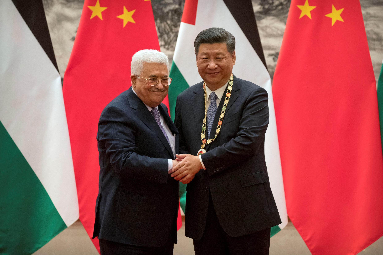 本周二中国国家主席与巴勒斯坦国总统阿巴斯会面资料图片