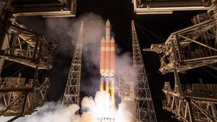 This handout photo released by NASA shows the United Launch Alliance Delta IV Heavy rocket with the Parker Solar Probe onboard during its launch on August 12, 2018 at Cape Canaveral Air Force Station in Florida.