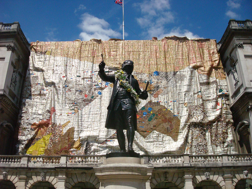 """""""Tsiatsia  - searching for connection"""", an installation by Ghanaian artist El Anatsui, on the façade of the Royal Academy of Arts in Britain (2013)"""