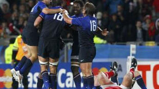 Exultant French players celebrate their win