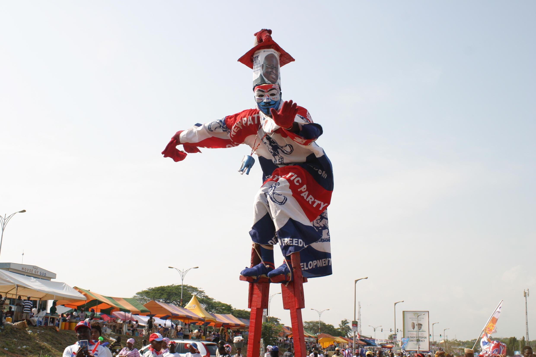 Stilt walker dressed in NPP colours wanders around Trade Fair Park.