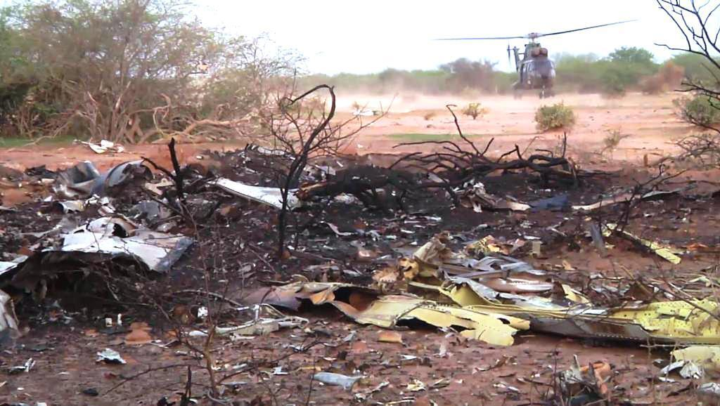 A French military helicopter lands at the crash site in Mali