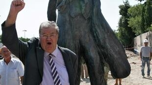 French politician Georges Freche near statue of Lenin in Montpellier