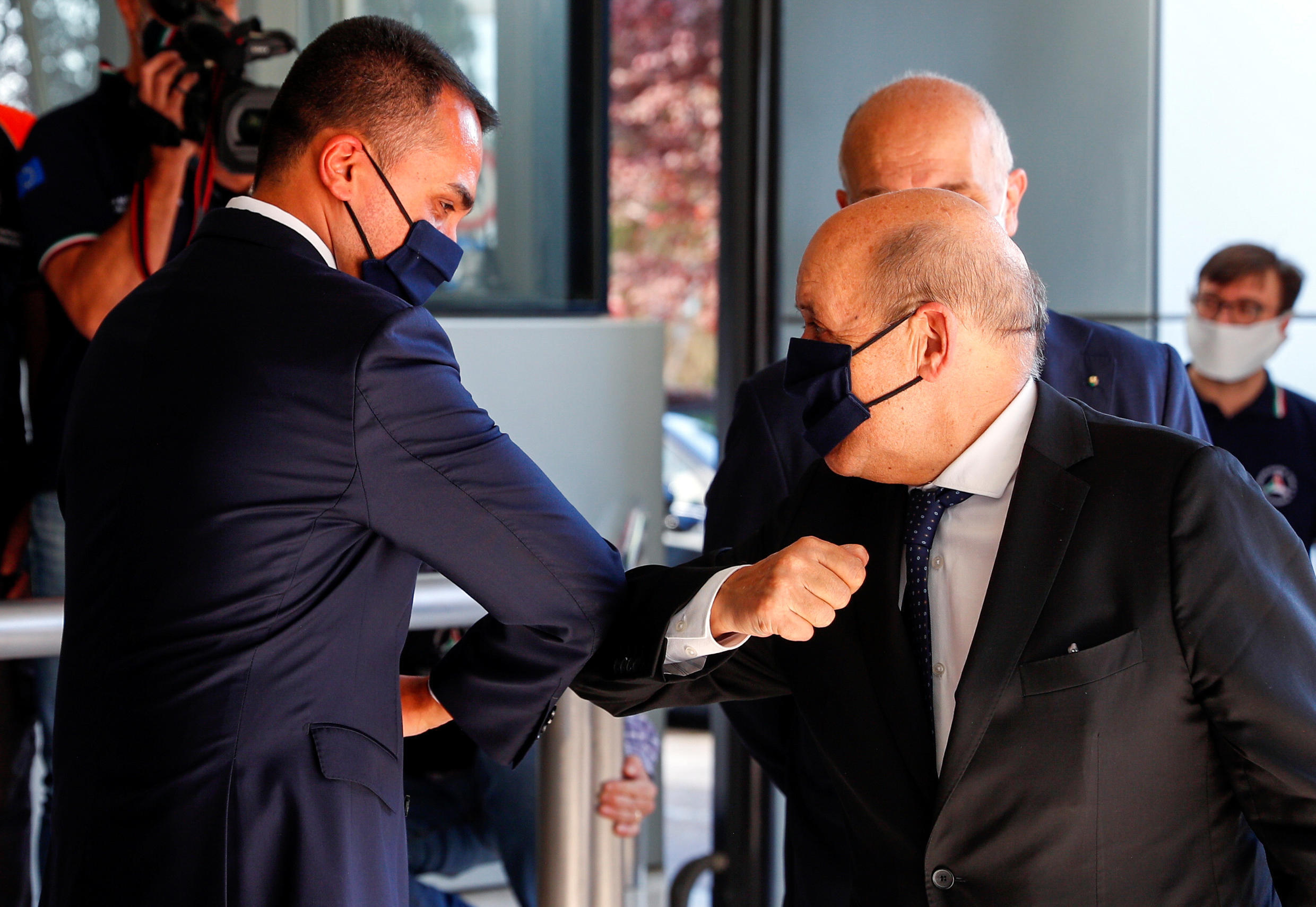 Italian Foreign Minister Luigi Di Maio and French Foreign Minister Jean-Yves Le Drian greet each-other with their elbows as they arrive at the Civil Protection Agency headquarters in Rome, Italy, June 3, 2020.