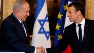 French President Emmanuel Macron and Israeli Prime Minister Benjamin Netanyahu attend a joint news conference at the Elysee Palace in Paris, France December 10, 2017.