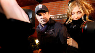 Carlos Ghosn, accompanied by his wife, Carole arrives at his residence in Tokyo in March