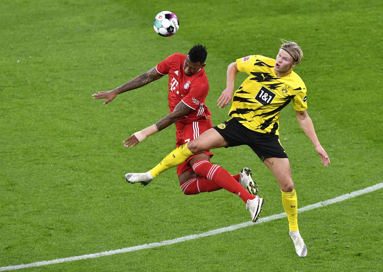 Le défenseur du Bayern Munich, Jérôme Boateng, et l'attaquant du Borussia Dortmund, Erling Haaland.