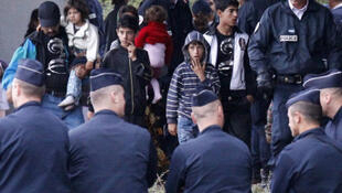 French police round up Roma people who live in makeshift camps across the country