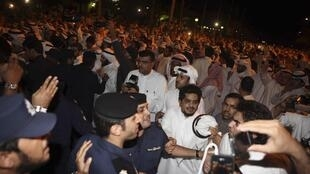Kuwaitis storming the parliament building late Wednesday