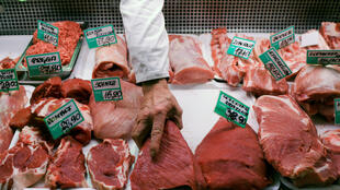A butcher arranges pieces of beef at a meat market in Gdynia, Poland. 31 January, 2019.